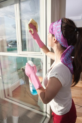 Window cleaning by Golden Touch Cleaning LLC - women cleaning window